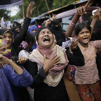 Illustrative: Rohingya women cry and shout slogans during a protest rally to commemorate the first anniversary of Myanmar army's crackdown on Rohingya Muslims, Kutupalong refugee camp in Bangladesh, August 25, 2018. (AP Photo/Altaf Qadri)