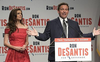 Florida Republican gubernatorial candidate Ron DeSantis, right, speaks to supporters with his wife Casey (l) at an election party after winning the Republican primary Tuesday, Aug. 28, 2018, in Orlando, Florida. (AP Photo/Phelan M. Ebenhack)