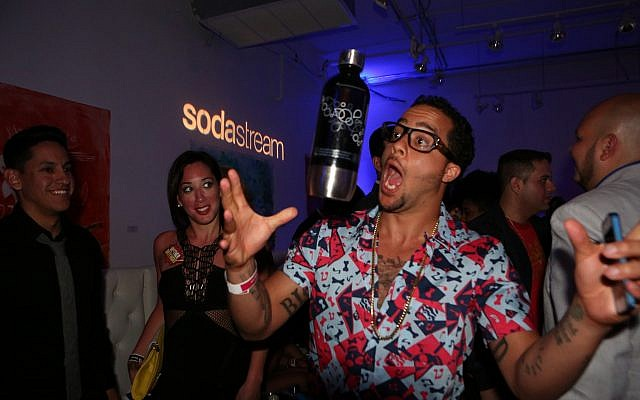Sky Blu from LMFAO tossing a SodaStream bottle at the Universal Music Latin Entertainment Billboard after party on Thursday, April 25, 2013 in Miami, FL (Marianela Sanchez/Invision for SodaStream/AP Images)