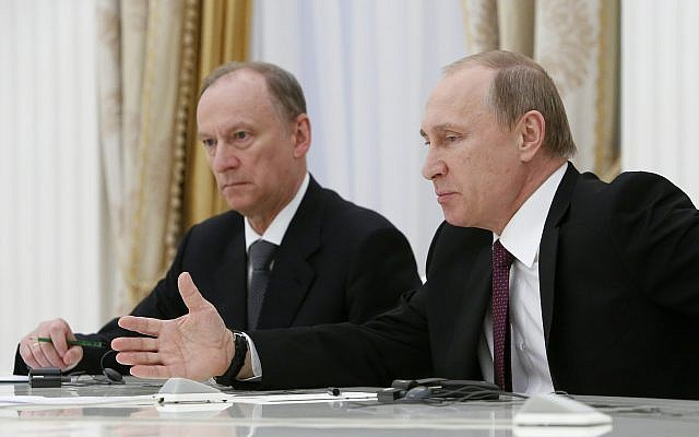 Russian President Vladimir Putin, right, flanked by Security Council Secretary Nikolai Patrushev, meets with the BRICS countries' senior officials in charge of security matters, at the Kremlin in Moscow, Russia, on May 26, 2015. (Sergei Karpukhin/Pool Photo via AP)