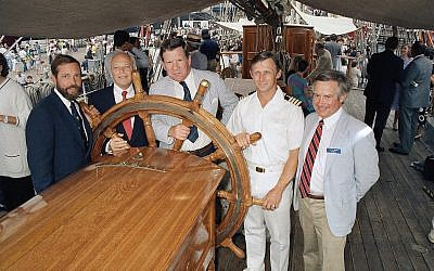 "A. R. ""Babe"" Schwartz, second left, at a party at Pier 16 for friends of Texas in New York, July 2, 1986. (AP/Rick Maiman)"