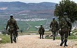 Spanish UN peacekeepers patrol in the disputed Shebaa Farms area between Lebanon and Israel, overlooking the divided border village of Ghajar, southeast Lebanon, Tuesday Feb. 24, 2015. (AP /Hussein Malla)