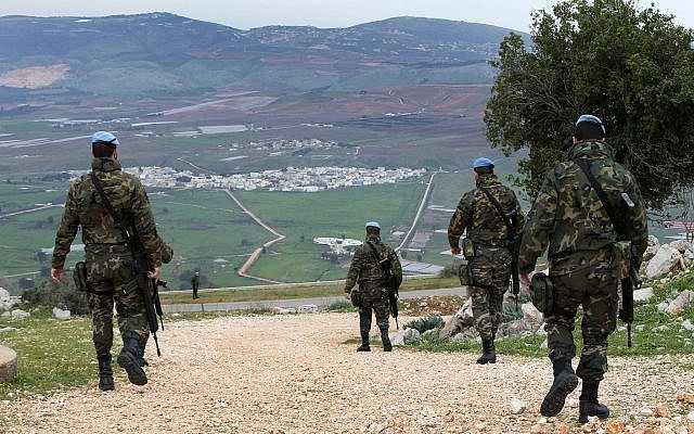 Spanish UN peacekeepers patrol in the disputed Shebaa Farms area between Lebanon and Israel, overlooking the divided border village of Ghajar, southeast Lebanon, February 24, 2015. (AP /Hussein Malla)