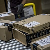 Parcels are processed and prepared for dispatch at the Amazon.com fulfillment center in Amazon.com MPX5 fulfillment center on November 17, 2017 in Castel San Giovanni, Italy. (Emanuele Cremaschi/Getty Images via JTA)