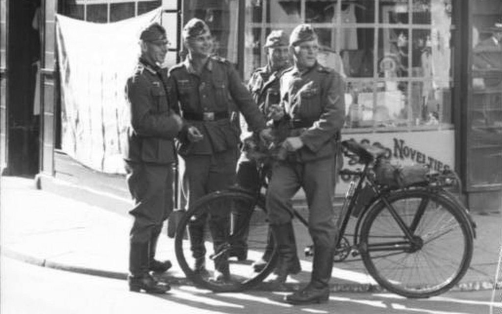 German soldiers standing in King Street, Saint Helier, at Charing Cross (now site of La Croix de la Reine monument) during the occupation of the Channel island of Jersey in World War II. (Bundesarchiv Bild)
