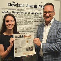 Columbus Bureau Chief Amanda Koehn and Publisher and CEO Kevin S. Adelstein hold up the inaugural issue of the new biweekly Columbus Jewish News, which debuted August 9. (Cleveland Jewish News via JTA)