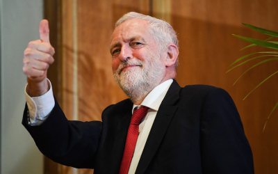 UK Labour Party leader Jeremy Corbyn leaves the stage after delivering a speech at Queens University in Belfast, Northern Ireland, May 24, 2018. (Jeff J. Mitchell/Getty Images via JTA)