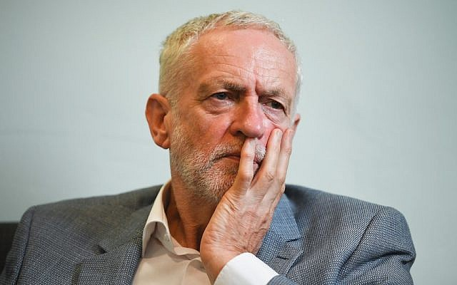Illustrative: Jeremy Corbyn meets with asylum seekers in Glasgow, Scotland, August 22, 2018. (Jeff J Mitchell/Getty Images via JTA)