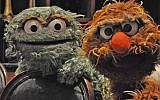 Oscar the Grouch, left, and his Israeli cousin Moishe Oofnik visited the Jewish federations' General Assembly in New Orleans to promote 'Shalom Sesame,' a version of 'Sesame Street' created for Israel's Educational Television channel, November 2010. (Daniel Sieradski via JTA)