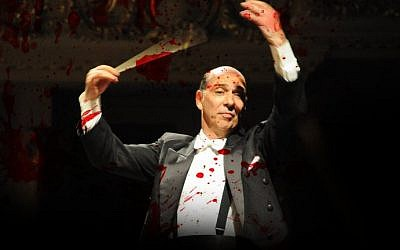 Poster distributed by the BDS movement of Chile showing Yeruham Scharovsky, conductor of the Jerusalem Symphony Orchestra, covered in blood. (Twitter)