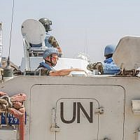 Members of the United Nations Disengagement Observer Force (UNDOF) enter Syria from the Quneitra crossing between Israel and Syria on August 30, 2014. (Flash90)