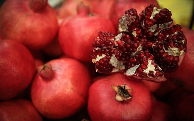 Pomegranates sold for the upcoming Jewish New Year, Rosh Hashana, at the Mahane Yehuda market in Jerusalem, on September 8, 2014. (Hadas Parush/Flash90)