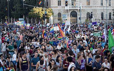People participate in the annual Gay Pride parade in central Jerusalem, under heavy security on August 3, 2017. (Yonatan Sindel/Flash90)