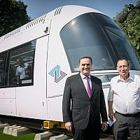 Transportation Minister Israel Katz, left, and Tel Aviv Mayor Ron Huldai, inaugurate the model of the new Tel Aviv Light Rail in Tel Aviv on September 13, 2017. (Miriam Alster/Flash90)
