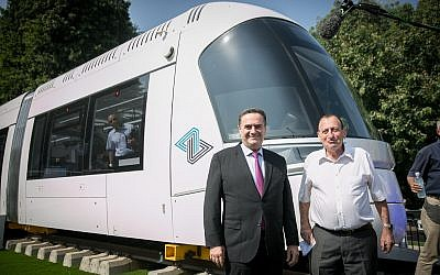 Transportation Minister Israel Katz, left, and Tel Aviv Mayor Ron Huldai, inaugurate the model of the new Tel Aviv Light Rail in Tel Aviv on September 13, 2017. (Miriam Alster/Flash90)