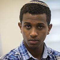Sintayehu Shafrao, an Ethiopian Jew who participated in the 2018 International Bible Quiz, is seen during a ceremony at the Interior Ministry in Jerusalem on April 16, 2018. (Yonatan Sindel/Flash90)