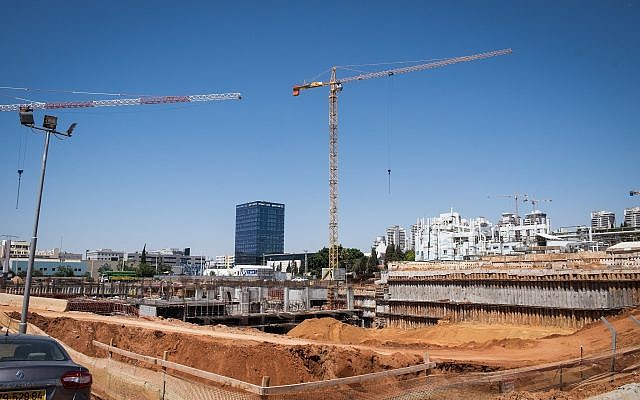 FILE -- A construction site in Petah Tikva where three workers were seriously injured in a fall, June 14, 2018 (Roy Alima/Flash90)