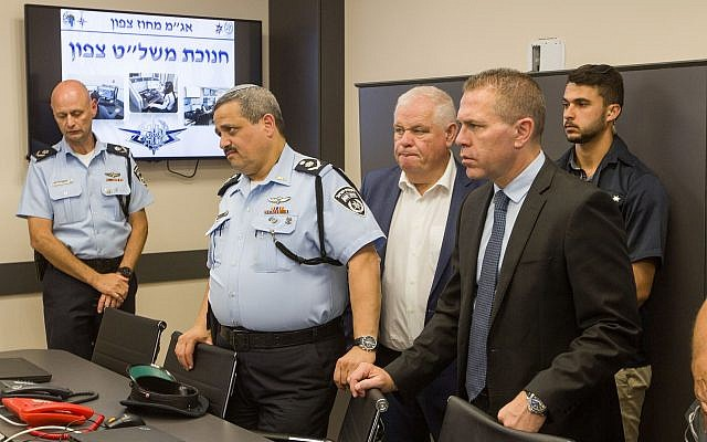 Gilad Erdan, right, and Israeli chief of Police Roni Alsheich, second left,  at an inauguration ceremony for a newly opened police control center in Nazareth on June 21, 2018. (Meir Vaaknin/FLASH90)