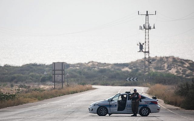 A Military Police car blocks a road leading to Zikim beach after it was closed to visitors, due to escalating rocket fire from the Gaza Strip toward southern Israel, on July 14, 2018. (Hadas Parush/Flash90)
