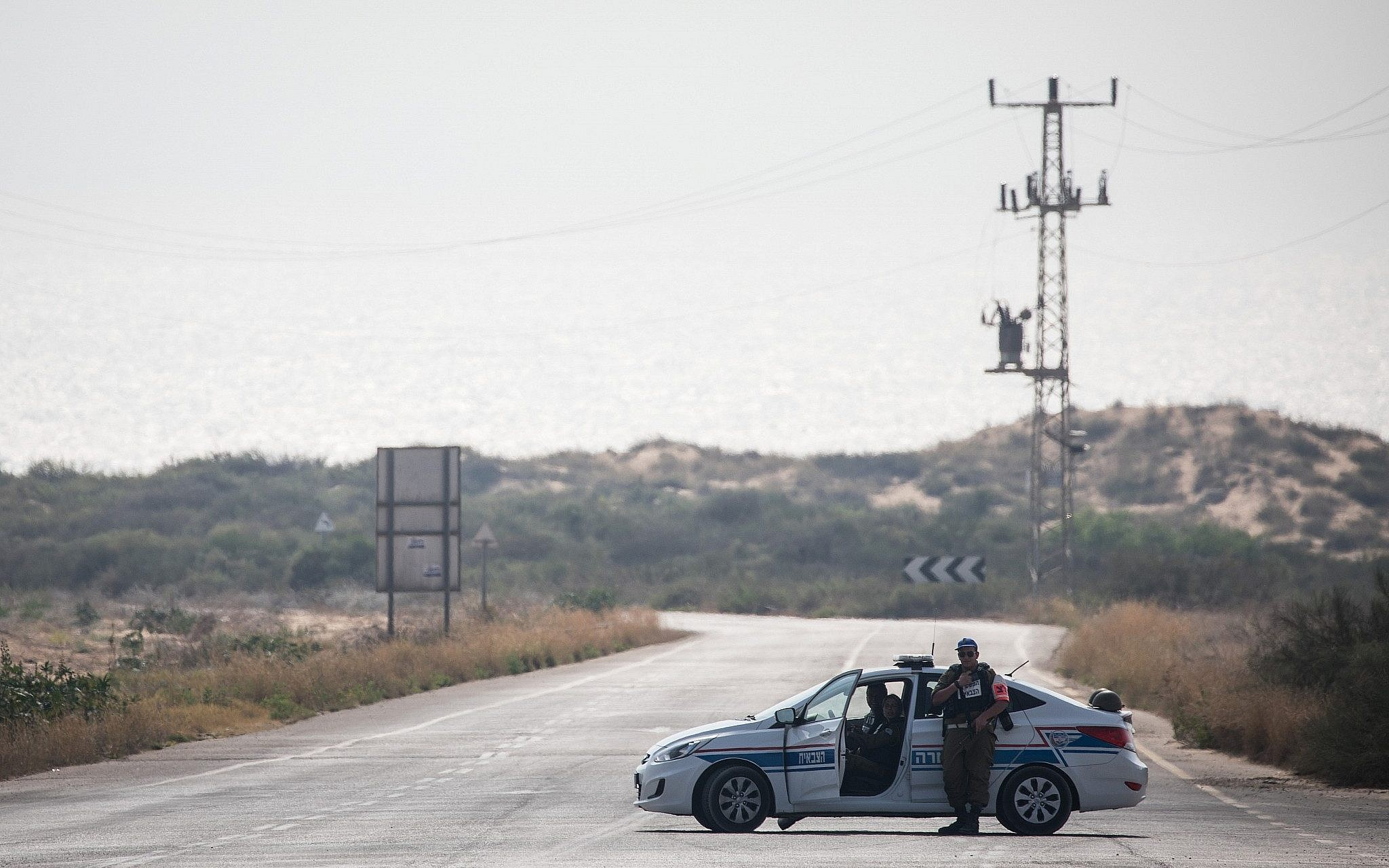 A Military Police car blocks a road leading to Zikim beach after it was closed to visitors due to escalating rocket fire from the Gaza Strip toward southern Israel