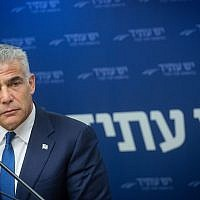 Yesh Atid leader Yair Lapid heads a party faction meeting at the Knesset on July 16, 2018. (Miriam Alster/Flash90)
