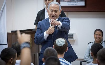 Israeli Prime Minister Benjamin Netanyahu speaks with newly recruited Israeli soldiers at the Tel haShomer army base on July 26, 2018. (Miriam Alster/Flash90)