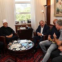 Prime Minister Benjamin Netanyahu, 2r, meets with the spiritual leader of the Druze community in Israel, Sheikh Muafak Tarif, 2l, at the Prime Minister's Office in Jerusalem on July 27, 2018. (Kobi Gideon/GPO)