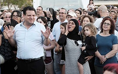 Joint List party leader Ayman Odeh (L) attends a protest against the nation-state law in Tel-Aviv on July 30, 2018 (Tomer Neuberg/Flash90)
