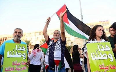 Arab Israelis and activists protest against the 'Nation-State law' in Tel Aviv on August 11, 2018. (Tomer Neuberg/Flash90)
