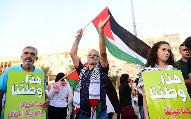 Arab Israelis and activists protest against the 'Jewish Nation-State law' in Tel Aviv on August 11, 2018. (Tomer Neuberg/Flash90)