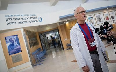 Dr. David Raveh-Brawer gives a statement  about several cases of leptospirosis in the Golan Heights, at the Shaare Zedek Medical Center in Jerusalem on August 13, 2018. (Yonatan Sindel/Flash90)