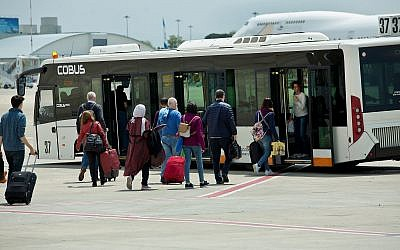 Travellers seen being transferred from the airplane to the arrival hall of Ben Gurion International Airport, near Tel Aviv, on April 11, 2018. (Moshe Shai/FLASH90)
