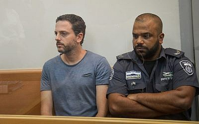Beno Reinhorn, a handball coach who is allegedly accused of sexually abusing more than 140 girls vioa the internet, at the Rishon Lezion Magistrate's Court, August 20, 2018 (Flash90)