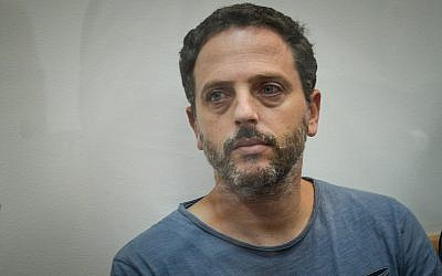 Beno Reinhorn, a youth sports coach suspected of molesting dozens of underage girls online, is seen at the Rishon Lezion Magistrate's Court on August 20, 2018. (Flash90)