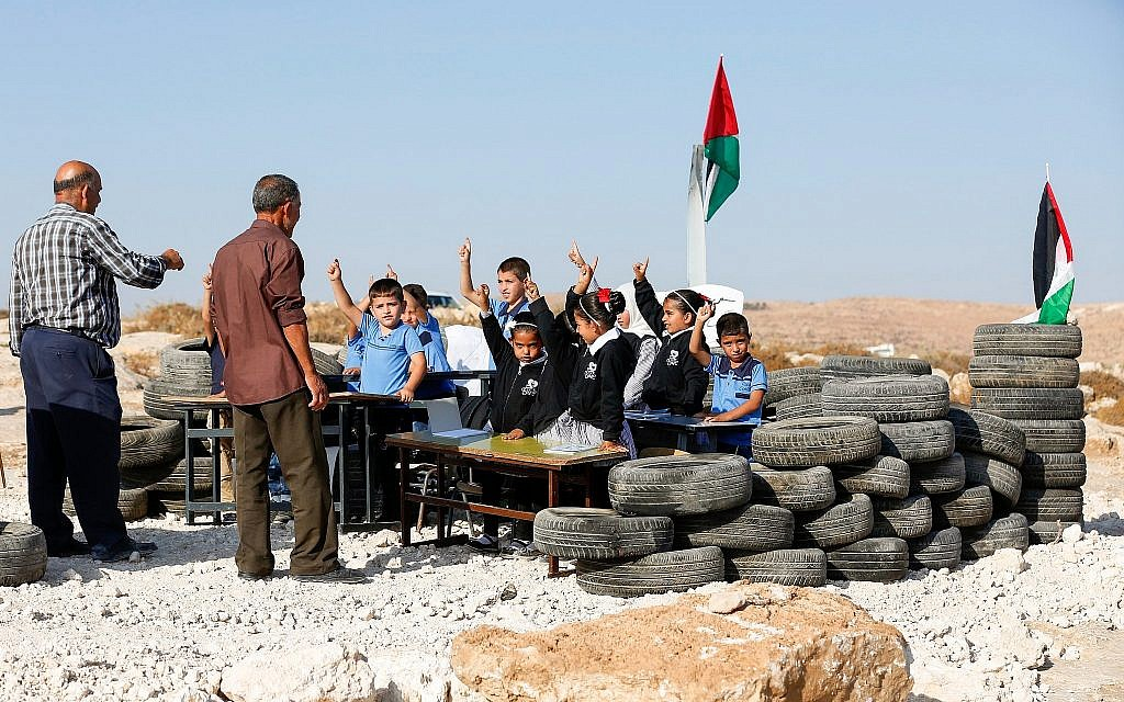 Palestinian school student study at their school that was demolished by Israeli authorities in the area of Khallet al-Daba south of Yatta in the city of Hebron on August 29, 2018. (Wisam Hashlamoun/Flash90)