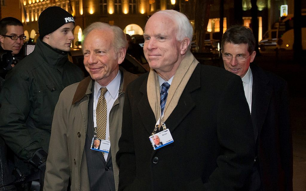 US Senator Joseph Lieberman (L) and US Senator John McCain  arrive for the 50th Munich Security Conference in the Bayerischer Hof hotel on January 31, 2014 in Munich, Germany. (Joerg Koch/Getty Images via JTA)