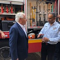 US Ambassador to Israel David Friedman, left, and Israeli Fire and Rescue Services Commissioner Dedi Simhi meeting at Sderot's fire station, August 1, 2018. (Avida Landau/US Embassy in Israel)