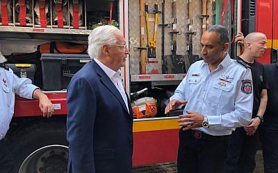 US Ambassador to Israel David Friedman, left, and Israeli Fire and Rescue Services Commissioner Dedi Simhi meeting at Sderot's fire station, August 1, 2018. (Avida Landau/US Embassy in Israel)