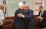 Prime Minister Benjamin Netanyahu greets Druze spiritual leader Sheikh Muafak Tarif at his office in Jerusalem on August 1, 2018. (Prime Minister's Office)