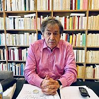 Alain Finkielkraut in his Paris home. (Robert Sarner/ Times of Israel)