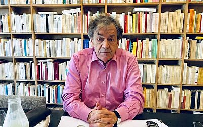 Alain Finkielkraut in his Paris home (Robert Sarner/Times of Israel)