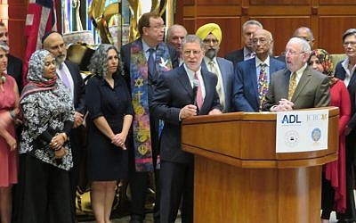 Rabbi Bruce Lustig of Washington Hebrew Congregation is surrounded by clergy of multiple faiths as he helps launch a weekend of counterprotests against white supremacist marchers in Washington, D.C., Aug. 10, 2018. (Ron Kampeas)