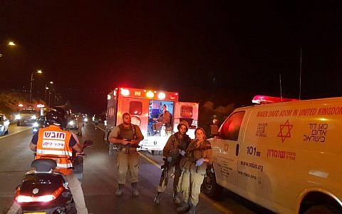 Soldiers and paramedics are seen at the scene where an Israeli woman was run over and killed by a Palestinian driver, near the northern West Bank settlement outpost of Havat Gilad on August 16, 2018. (Roi Hadi/Samaria Regional Council)
