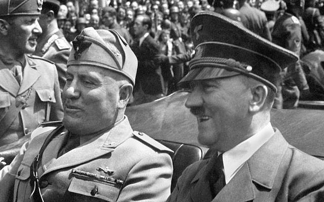 Mussolini and Hitler during a parade celebrating their alliance (public domain)
