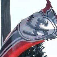 Screen capture from video of a Nazi flag raised in Preble, New York, August 2018. (Spectrum News)