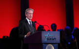 Former Senator Norm Coleman speaks at the 2016 Starkey Hearing Foundation awards gala in St Paul, Minnesota, July 17, 2016. (Adam Bettcher/Getty Images for Starkey Hearing Foundation via JTA)