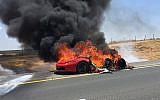 A burning Ferrari sports car is seen on Route 6 near the southern city of Kiryat Gat on August 10, 2018. (Israel Fire and Rescue Services Southern District)