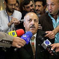 Ghasem Sholeh-Saadi speaks with media as he registers his candidacy for an upcoming presidential election in Tehran, Iran, Tuesday, May 7, 2013. (AP Photo/Vahid Salemi)