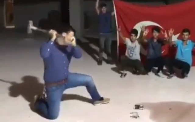 A Turkish man smashes iPhones in a video posted on August 16, 2018, after the Turkish president called for boycotting US products. (Screenshot: YouTube)
