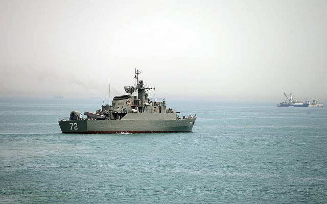 Illustrative: The Iranian warship Alborz, foreground, prepares to leave Iran's waters at the Strait of Hormuz, in this photo released April 7, 2015. (AP/Fars News Agency, Mahdi Marizad)